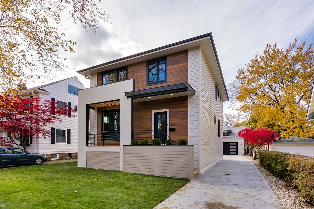 modern custom built home with wood facade detailing