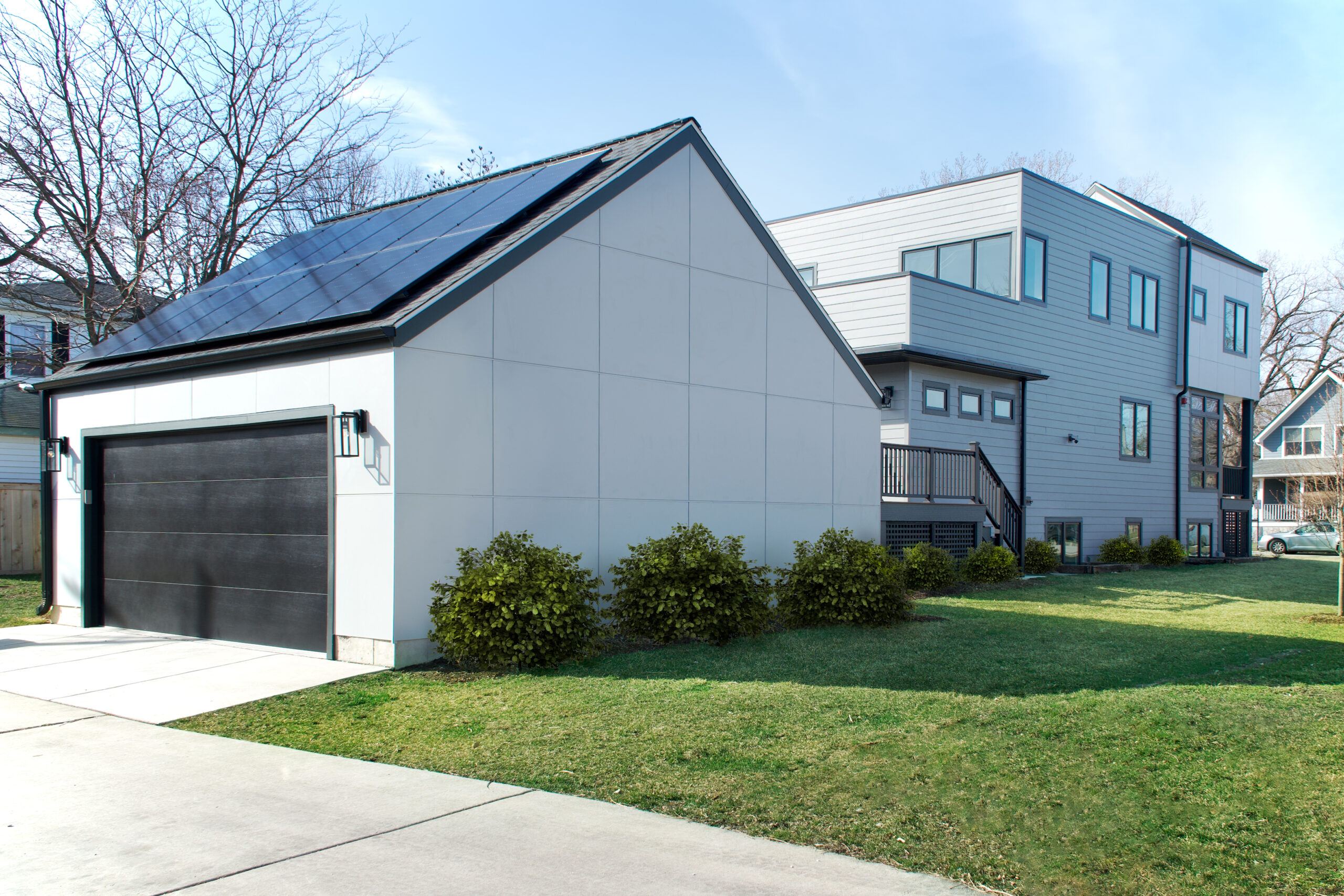 Garage View of Modern All Electric Home with Solar Panels on Roof