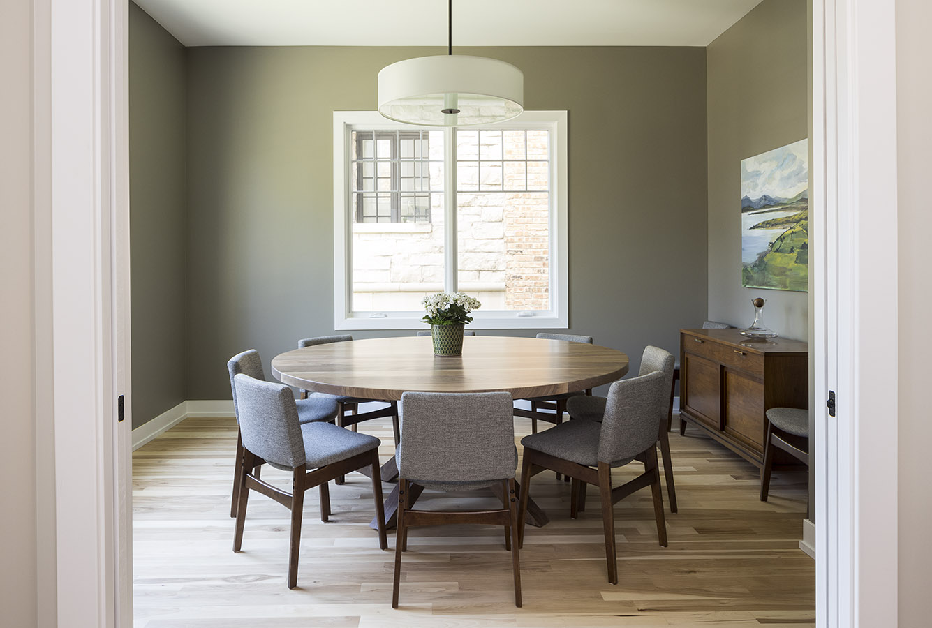 formal dining room with 8 person circular table and pocket doors