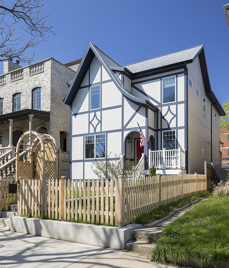 modern tudor with blue painted timbers in chicago